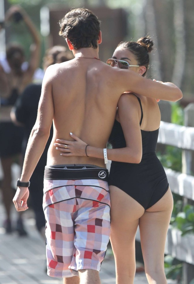 Madison Beer – In Black Swimsuit with Jack Gilinsky at a beach in Miami