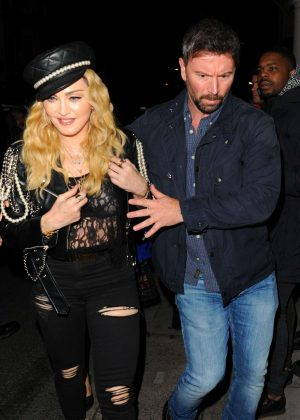 Madonna in Ripped Jeans out iin London