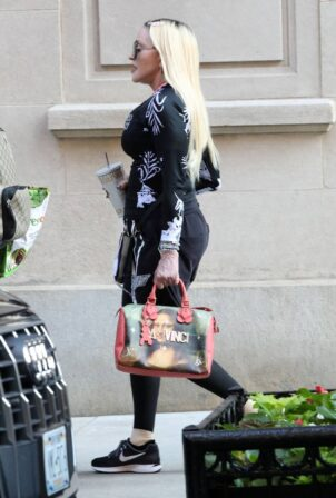 Madonna - Out with Louis Vuitton limited edition Jeff Koons Da Vinci purse in New York