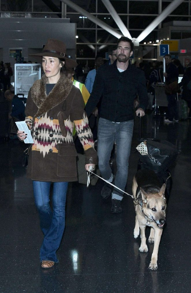 Maggie Q with her dog at JFK Airport in New York