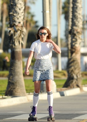 Maisie Williams in Mini Skirt Roller Skating -02