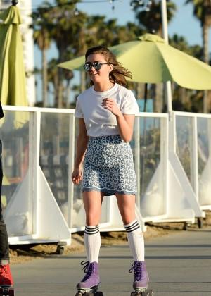 Maisie Williams in Mini Skirt Roller Skating -04