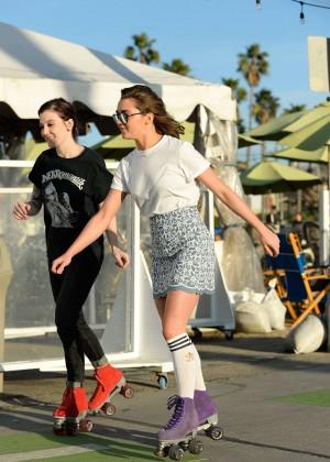 Maisie Williams in Mini Skirt Roller Skating -07