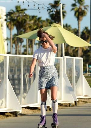 Maisie Williams in Mini Skirt Roller Skating -08