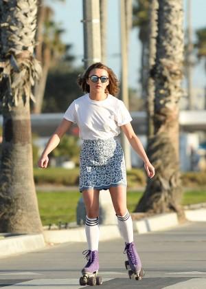 Maisie Williams in Mini Skirt Roller Skating -09