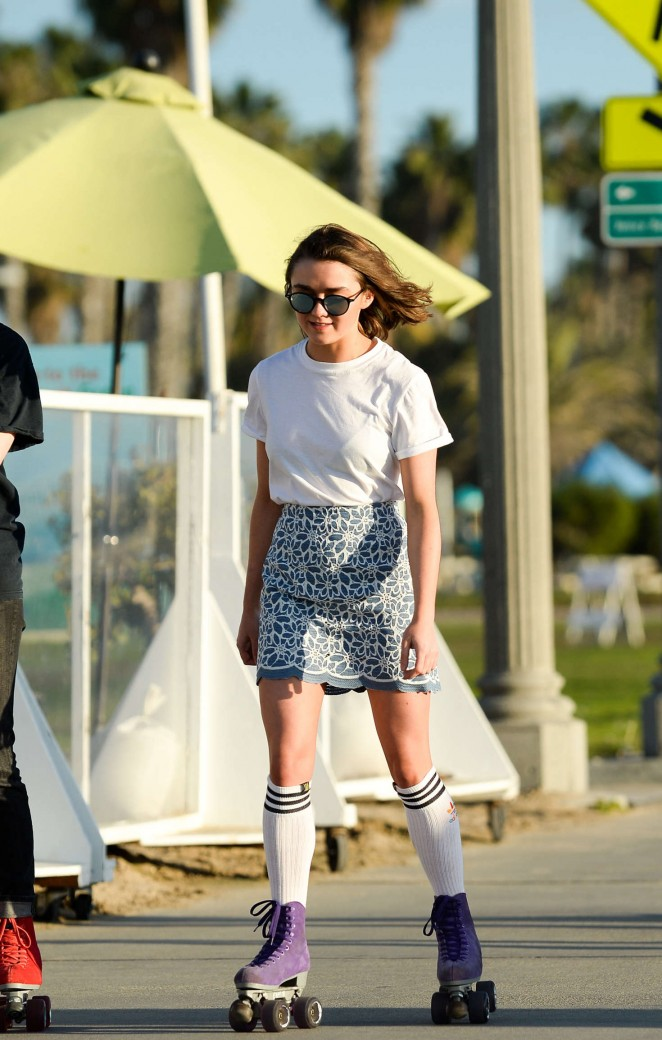 Maisie Williams in Mini Skirt Roller Skating in Santa Monica