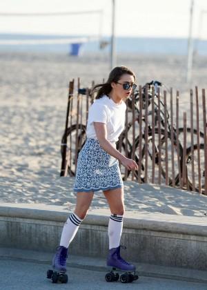 Maisie Williams in Mini Skirt Roller Skating -17
