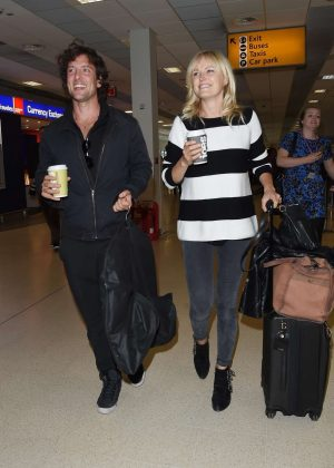 Malin Akerman and fiance Jack Donnelly - Arriving at Aberdeen Airport