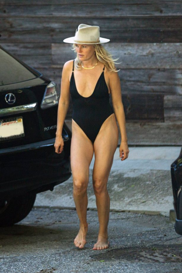 Malin Akerman - Spotted in a black swimsuit outside her home