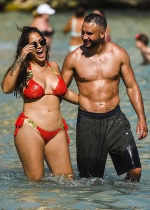 Malin Andersson in Red Bikini on the beach in Spain