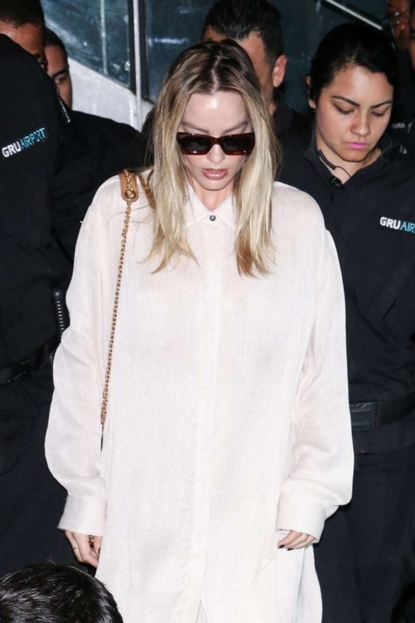 Margot Robbie - Arrives to the airport in Sao Paulo