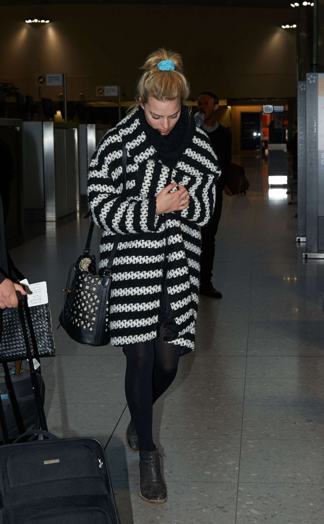 Margot Robbie at Heathrow Airport in London