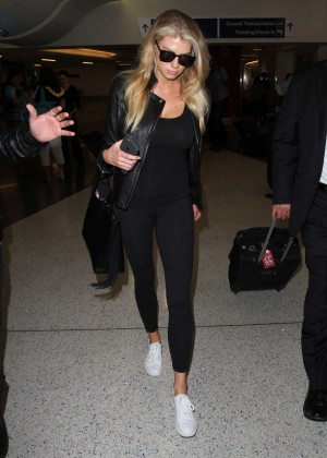 Margot Robbie in Black at LAX Airport -01