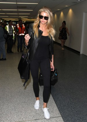 Margot Robbie in Black at LAX Airport -06