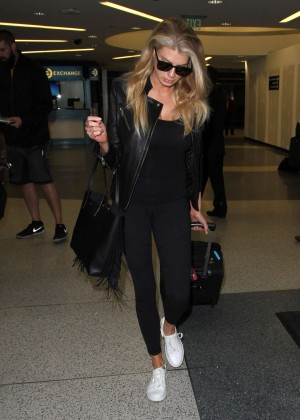 Margot Robbie in Black at LAX Airport -09