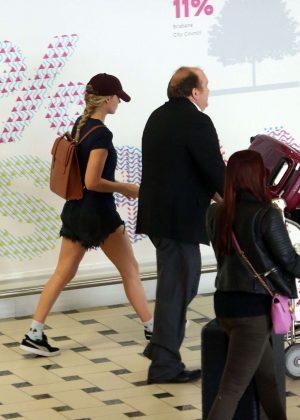 Margot Robbie in Jeans Shorts at Brisbane Airport in Australia