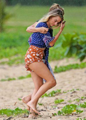 Margot Robbie in Shorts at a beach in Kauai