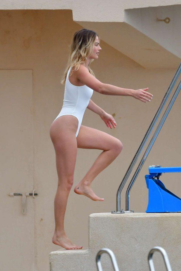 Margot Robbie in White Swimsuit at Eden Roc hotel in Cannes
