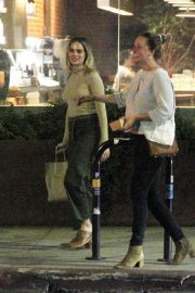 Margot Robbie - Leaving a restaurant with her friend in Los Angeles
