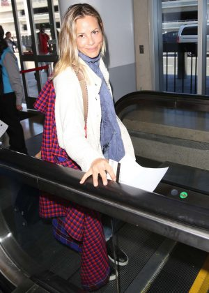 Maria Bello - Arrives at LAX Airport in Los Angeles