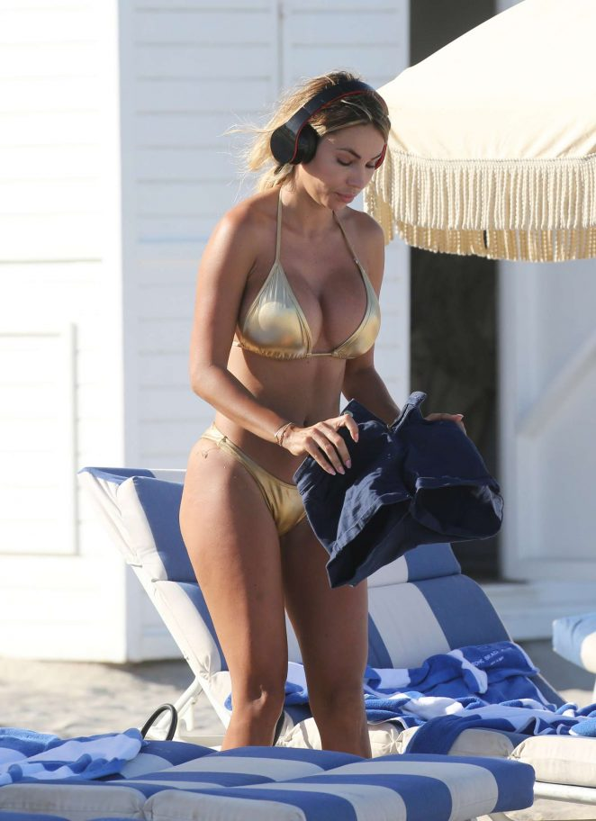 Maria Hering in Gold Bikini on the beach in Miami