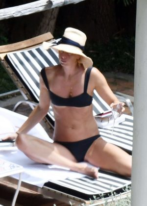 Maria Sharapova in Black Bikini at the pool in Positano
