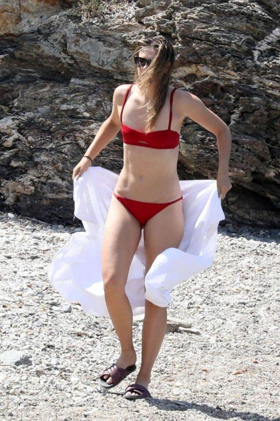 Maria Sharapova in Red Bikini on the beach in Isola d'Elba