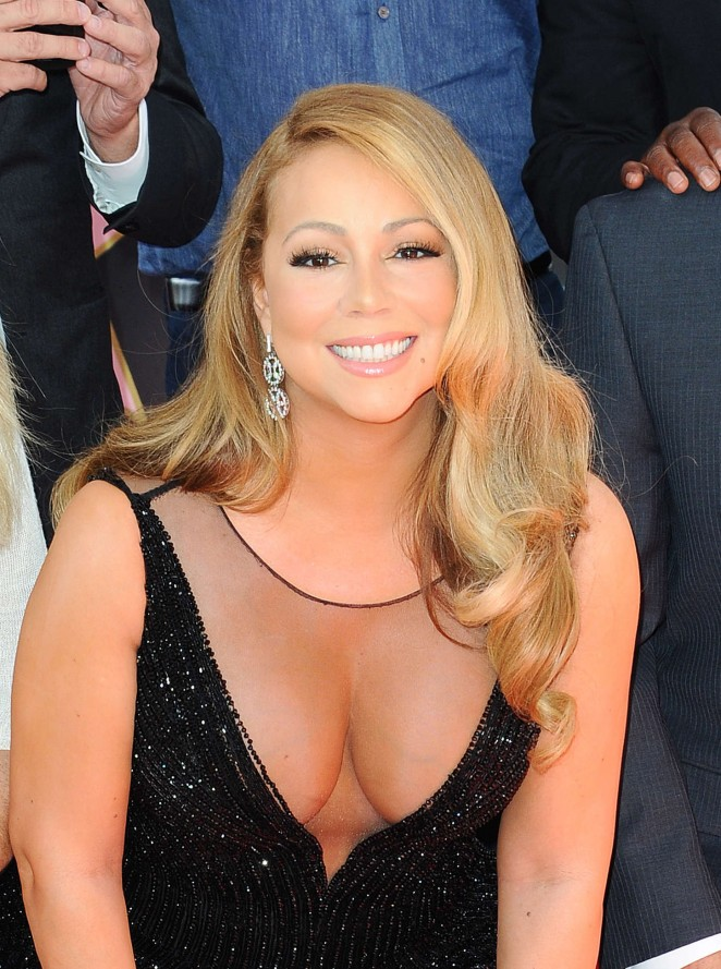 Mariah Carey - Honored with a star on the Hollywood Walk of Fame