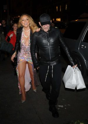 Mariah Carey in a low cut sparkly dress in New York