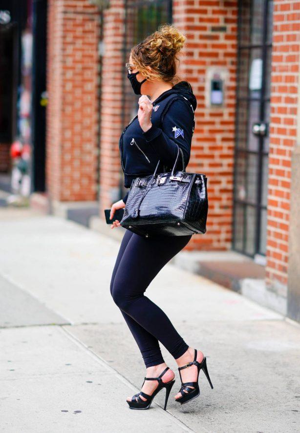 Mariah Carey - Wearing body hugging tights and heels in New York