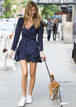 Martha Hunt walking her dog Bear in New York City