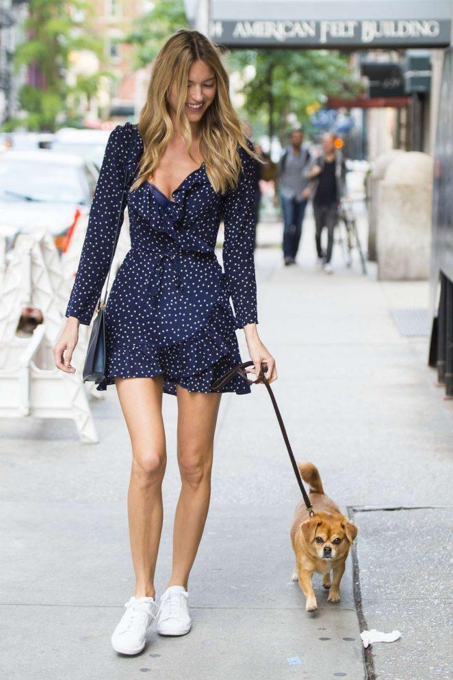 Martha Hunt walking her dog Bear in New York City