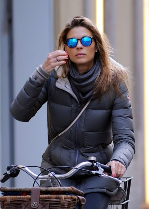 Martina Colombari Riding her bicycle in Milan