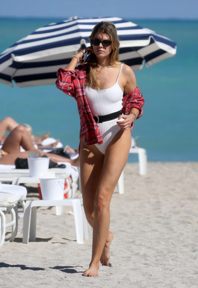 Maryna Linchuk in White Swimsuit on the beach in Miami
