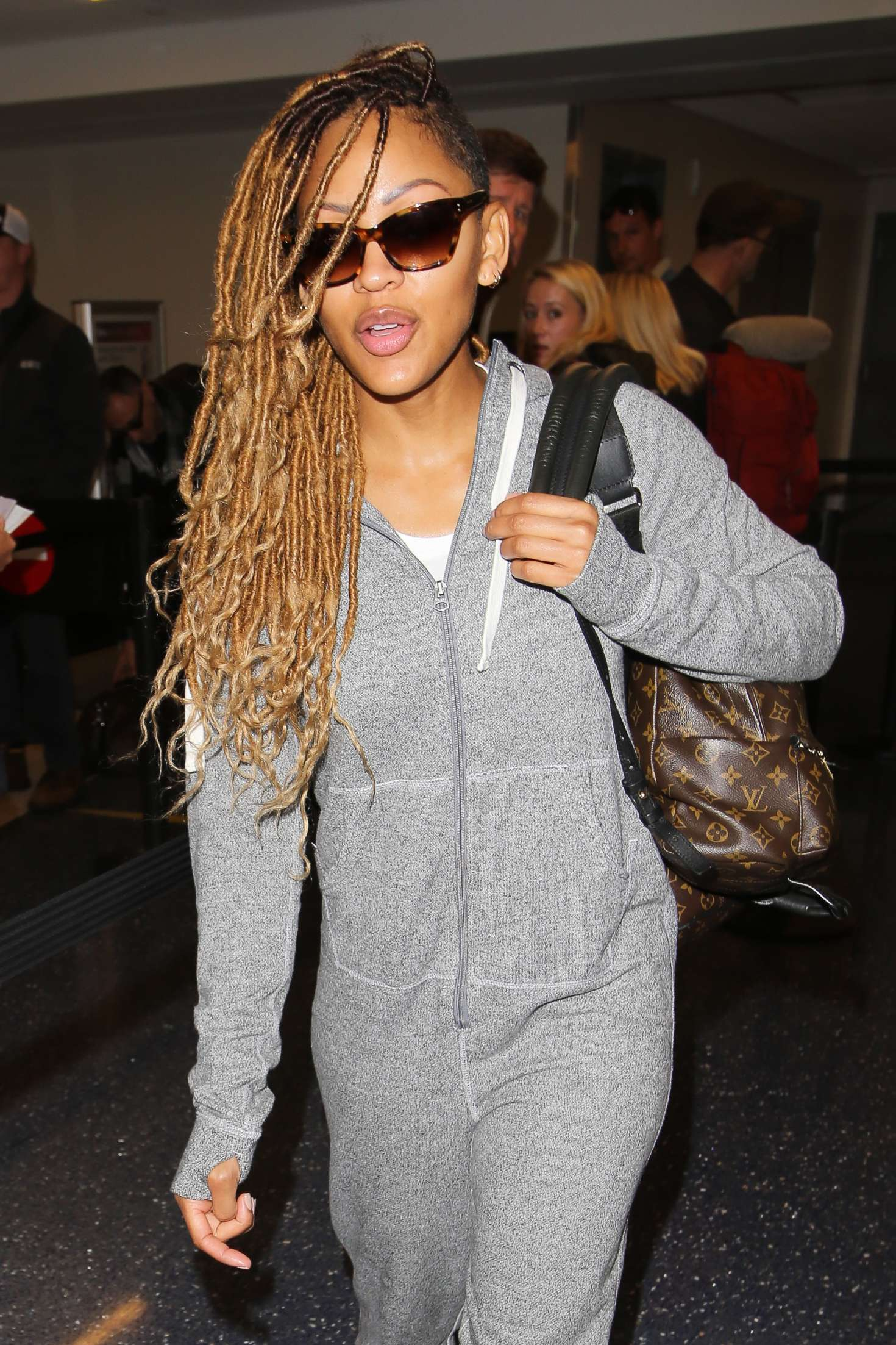 Meagan Good In Jumpsuit At Lax Airport In Los Angeles