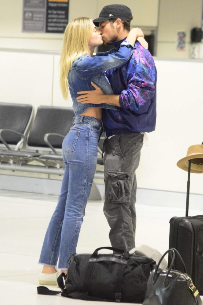 Megan Blake Irwin shares a kiss with Nicolo Knows at Sydney airport