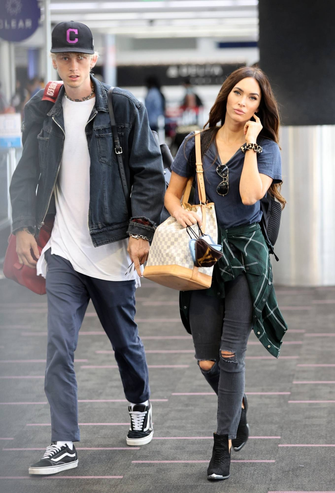 Megan Fox and Machine Gun Kelly - Arriving at LAX airport in Los Angeles