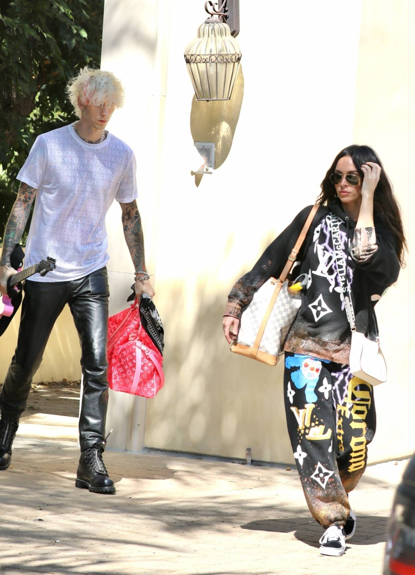 Megan Fox and Machine Gun Kelly leaving a house in Los Angeles