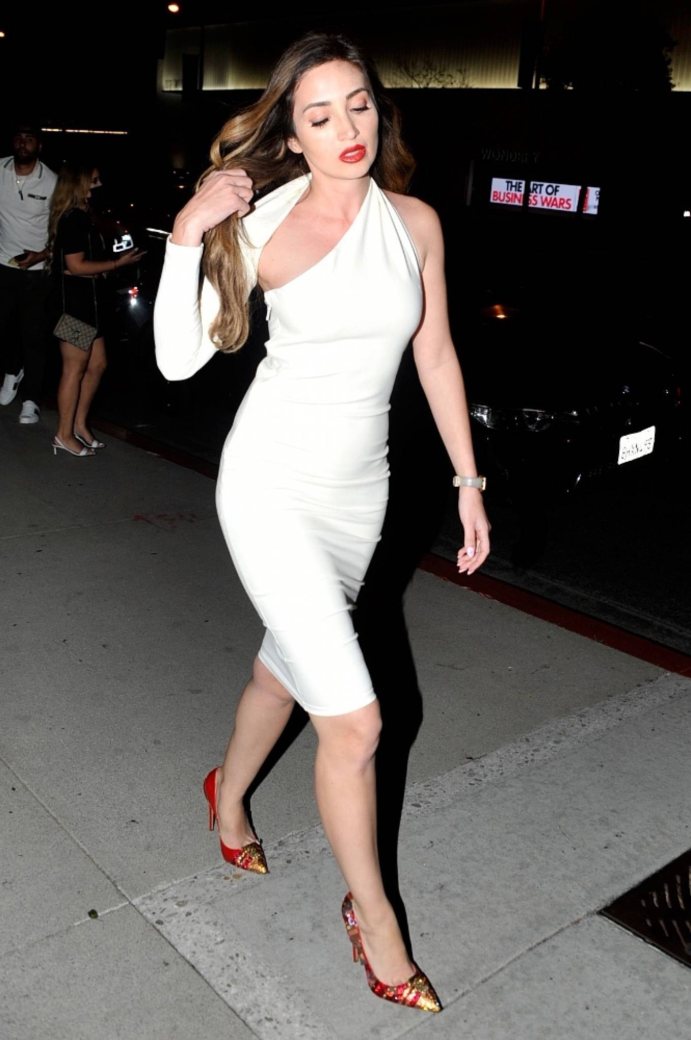 Megan Pormer 2021 : Megan Pormer – In white tight dress going to Nusr-Et Steakhouse in Beverly Hills-05