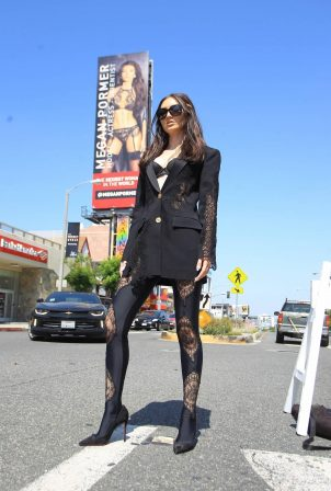 Megan Pormer - Posing in front of her billboard on Sunset in Hollywood