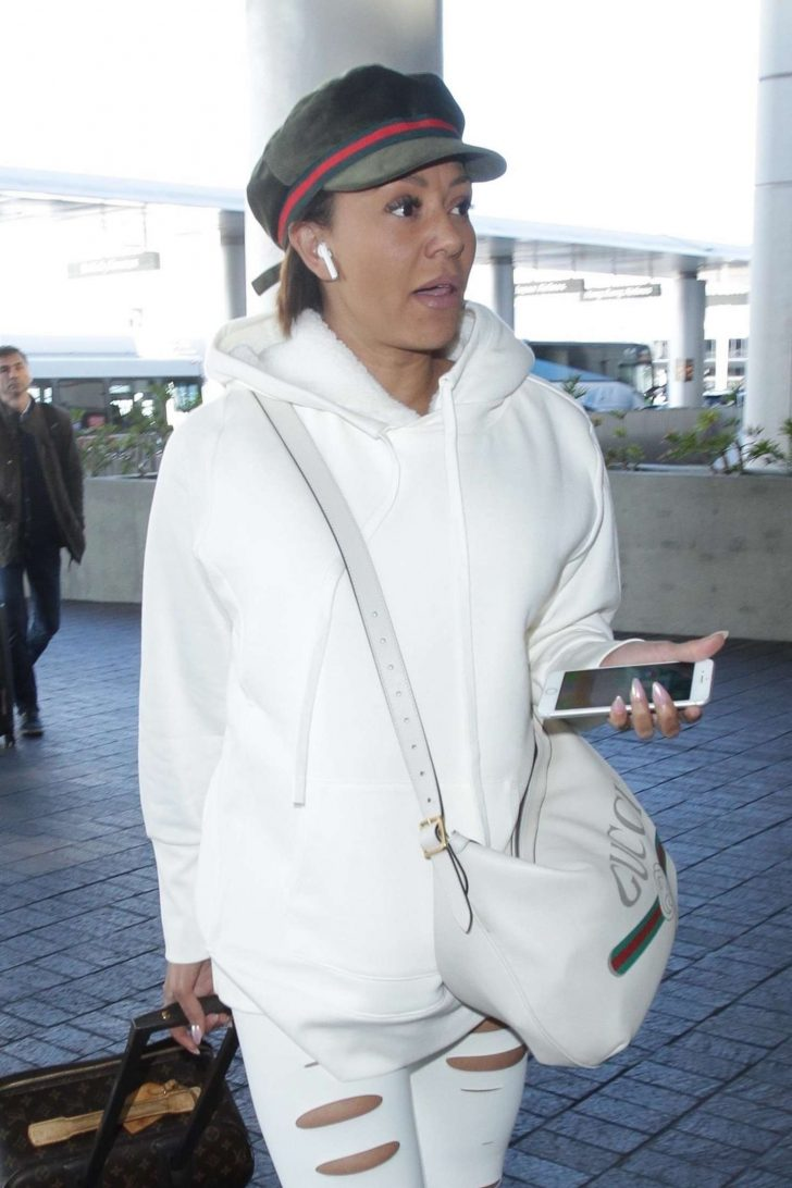 Melanie Brown - Arrives at LAX Airport in LA