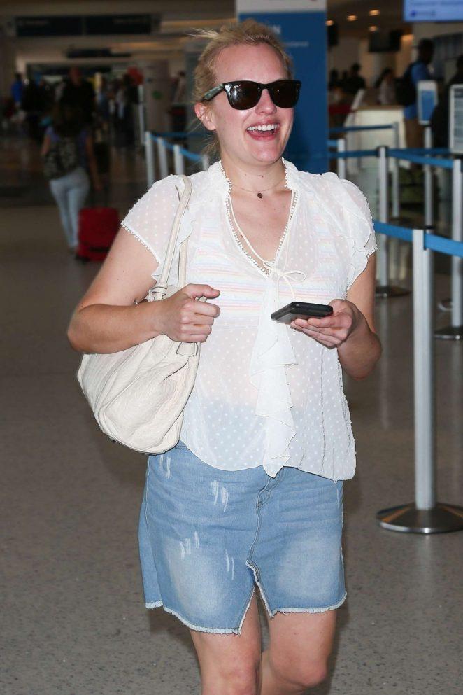 Melanie Brown in Mini Skirt - Arriving at LAX Airport in LA