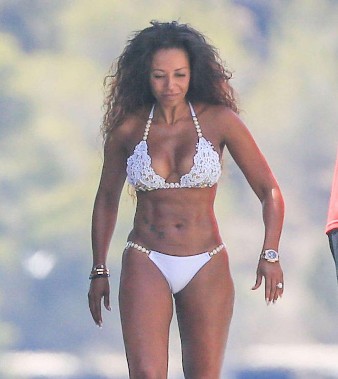 Melanie Brown in White Bikini on a yacht in Ibiza