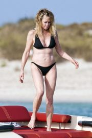 Melanie Griffith in Black Bikini on a luxury yacht in Formentera