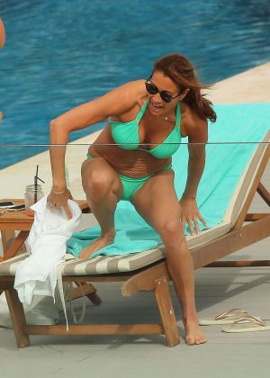 Melanie Sykes in Bikini sunbathes in Ibiza