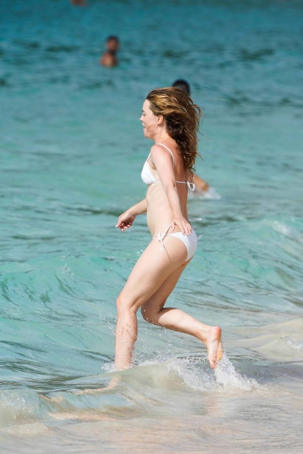 Melissa George - In white bikini on the beach in St. Barts