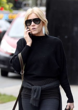 Michelle Collins with her dog out for a walk in London