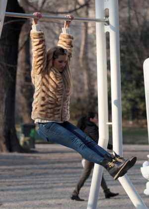 Michelle Hunziker having fun in a park in Milan
