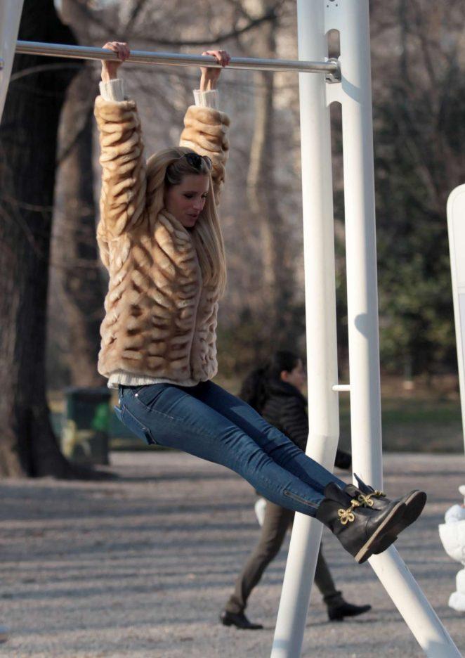 Michelle Hunziker having fun in a park in Milan