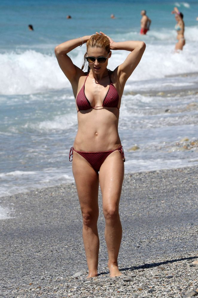 Michelle Hunziker in Bikini on the beach in Varigotti